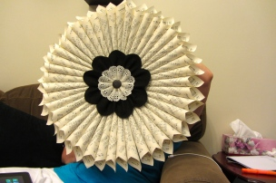 The beautiful wreath my mom made out of hymnal pages. I love it!