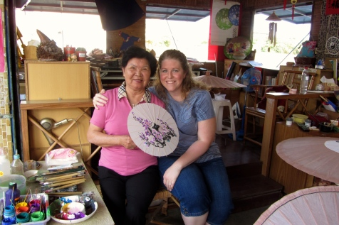 The artist and me with the gorgeous custom-colors umbrella that we'll be using (plus others like it with the same color scheme) as center pieces for the wedding.
