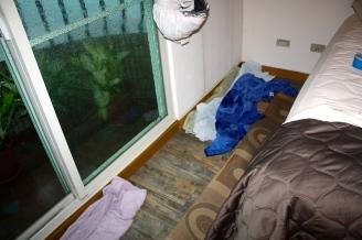 Bedroom carpet rolled back