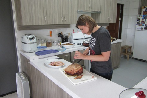 Cutting the ham.