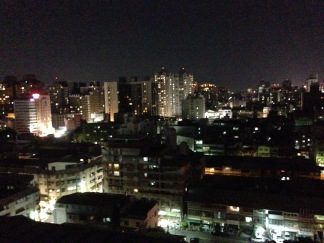 Our nighttime city view from the roof.